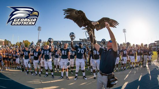 download a zoom background of an eagle in front of the georgia southern football team