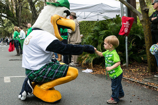 gus high fiving child at st.patrick's day parade