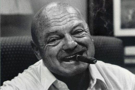 Erk Russell with a large cigar