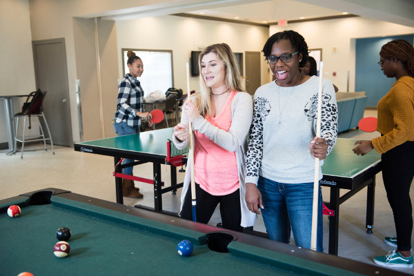 housing students playing pool and table tennis