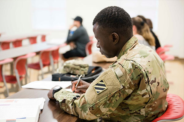 military student working in a classroom