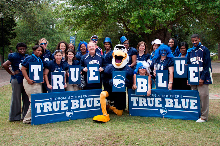 gus mascot and group of staff
