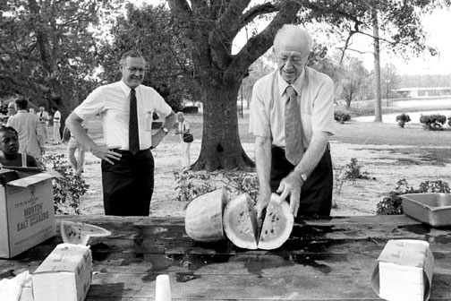 historic photo of watermelon cutting